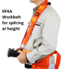 A man wearing a workbelt for holding a KF4A fusion splicer when working at height