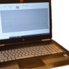 A slanted view of Networks OTDR Reporting software on laptop